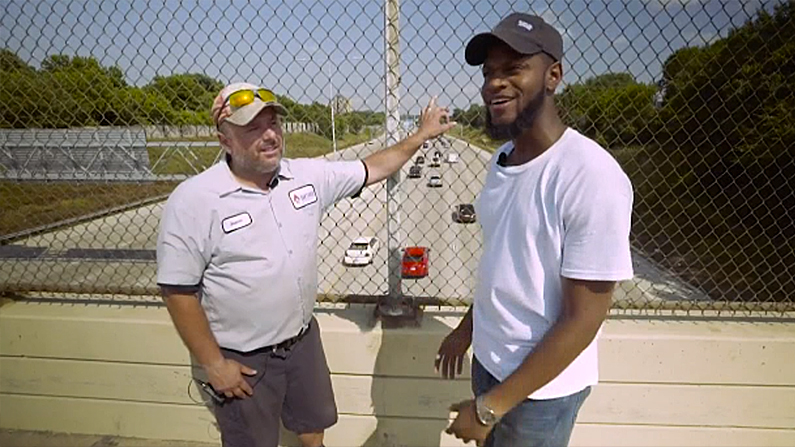 Jason Gabel and Kwame Anderson stand where they talked down a suicidal man