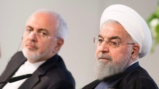 Iranian President Hassan Rouhani and Mohammad Javad Zarif