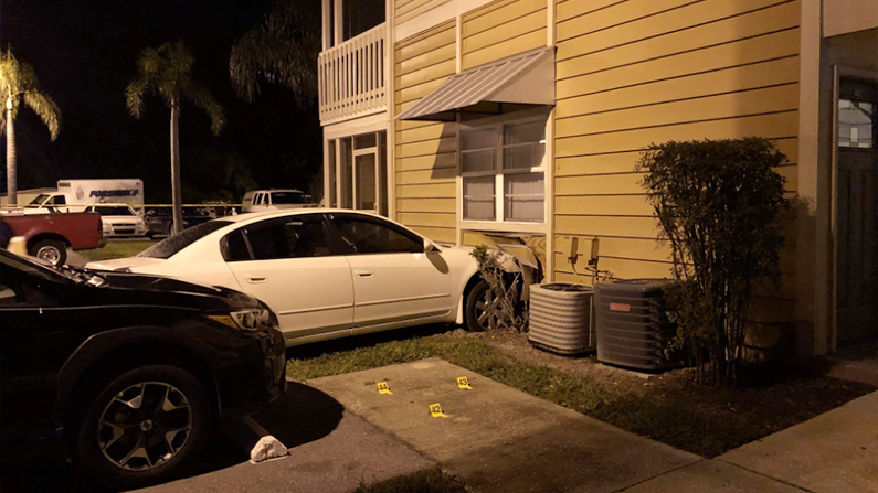 This Nissan slammed into a ground-floor apartment after its driver was shot