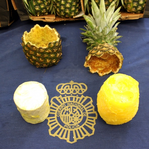 A hollowed-out pineapple with a wax cylinder containing cocaine, seized by Spanish police 26 Aug. 2018 in Madrid. Spain. (Policia National Espana)