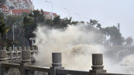The Latest: 2 Dead After Typhoon Slams Into Southern China