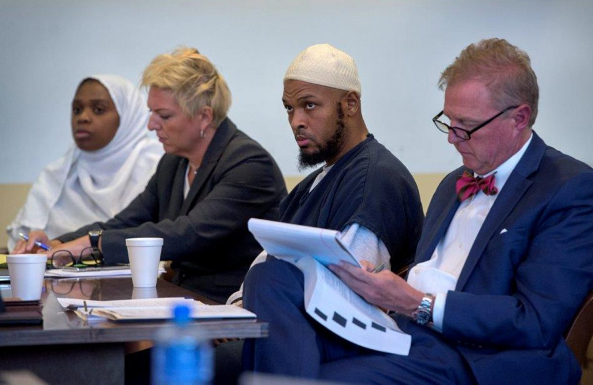 Jany Leveille (L to R) next to her defense lawyer Kelly Golightley, defendant Siraj Ibn Wahhaj and his defense lawyer Tom Clark at hearing in Taos County District Court in Taos County
