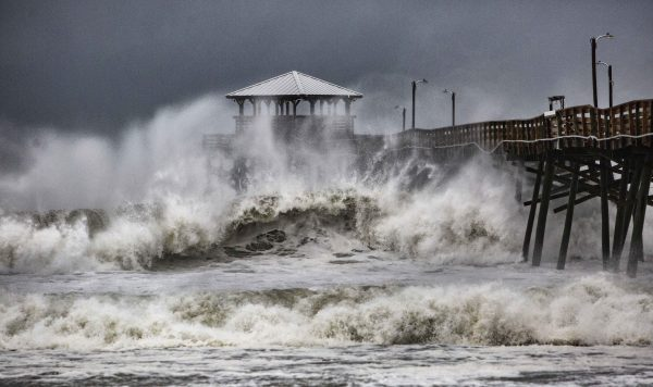 Waves slam against a pier in North Carolina