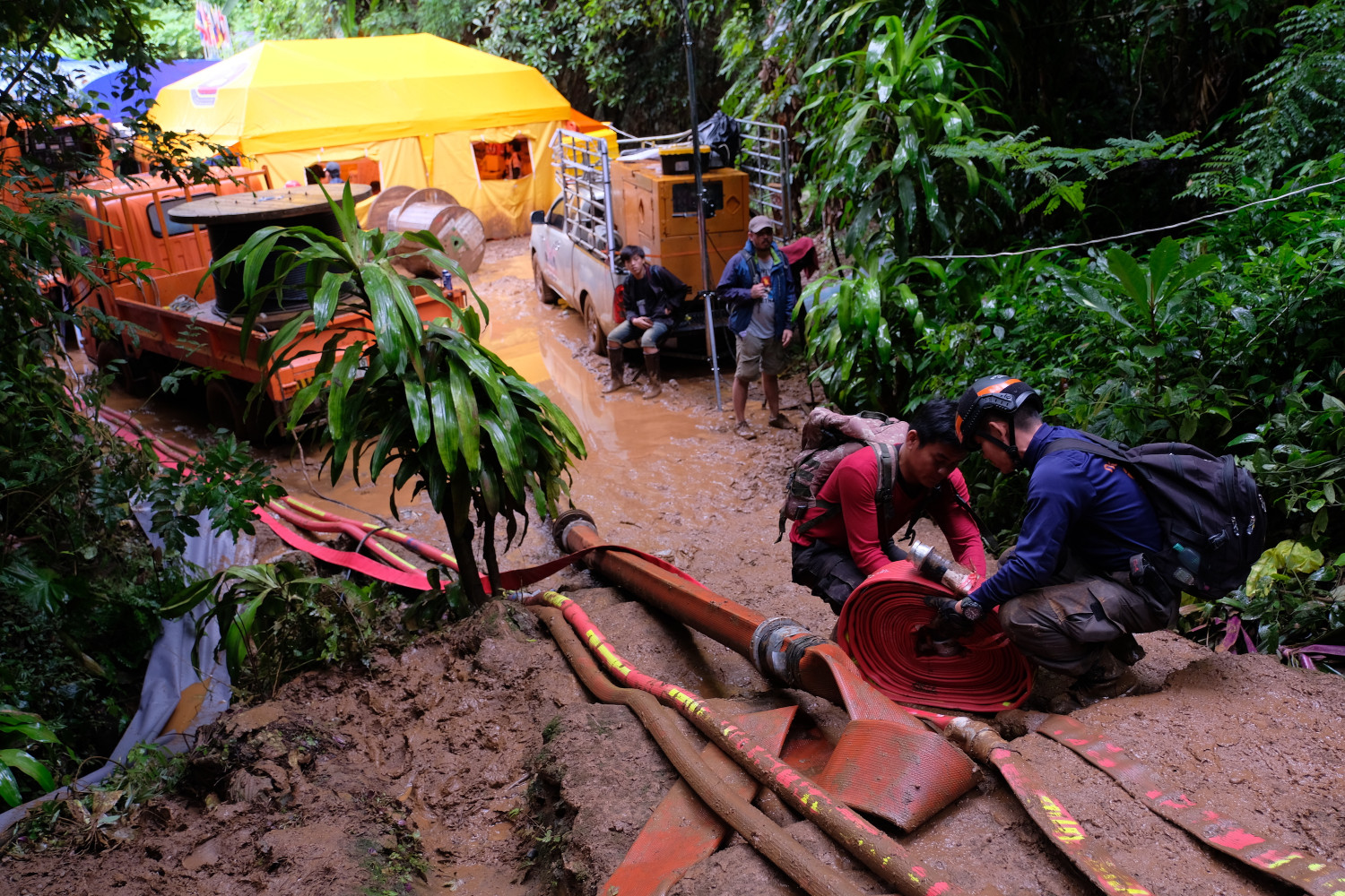 workers install a pump at the Thailand cave rescue site