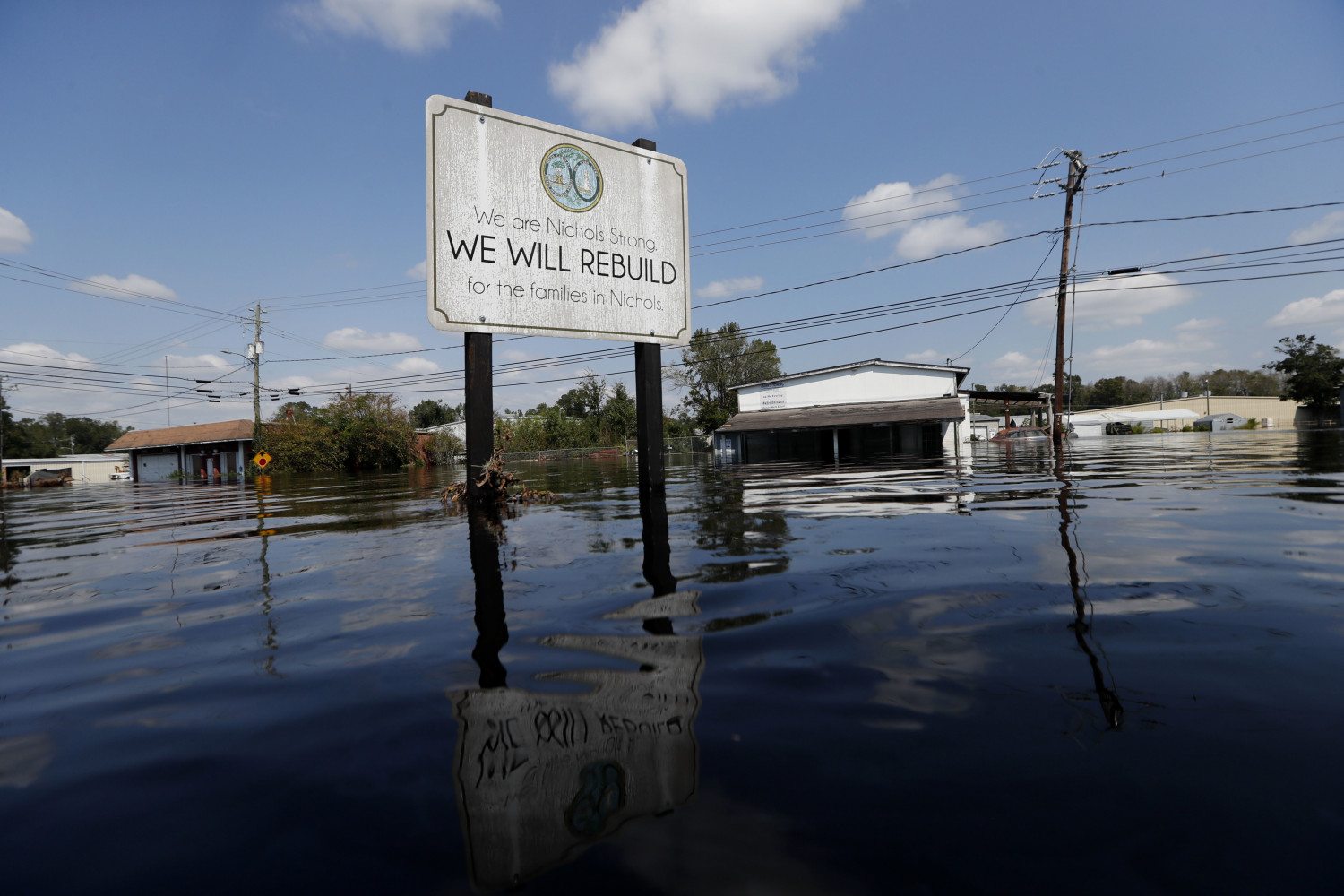 A sign inundated by water in Nichols, South Carolina