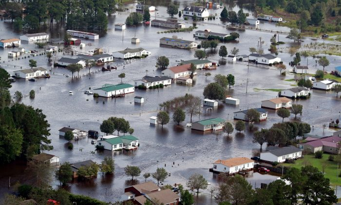 Houses sit in floodwater