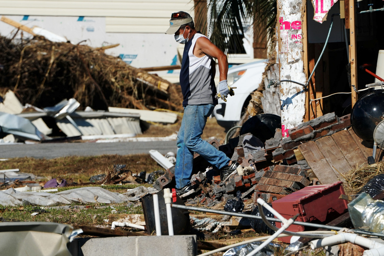 A man walks out of his home following Hurricane Michael in Mexico Beach