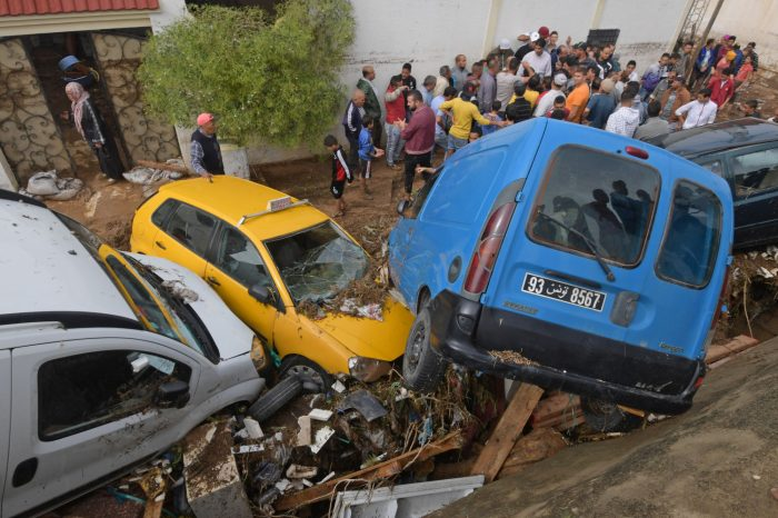 Cars piled up in the street after flood in Tunesia