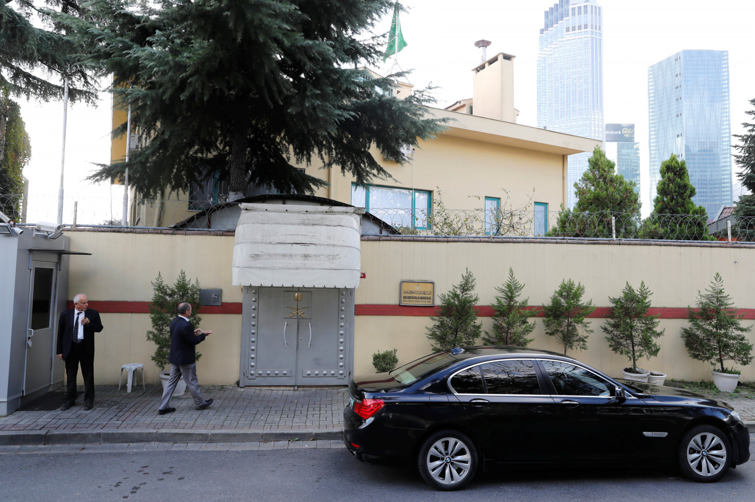 an official walks outside the saudi consulate in Istanbul