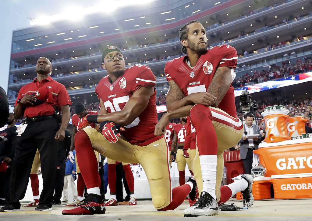 San Francisco 49ers safety Eric Reid (35) and quarterback Colin Kaepernick (7) kneel during the national anthem before an NFL football game against the Los Angeles Rams in Santa Clara, Calif. on Sept. 12, 2016. (AP Photo/Marcio Jose Sanchez)