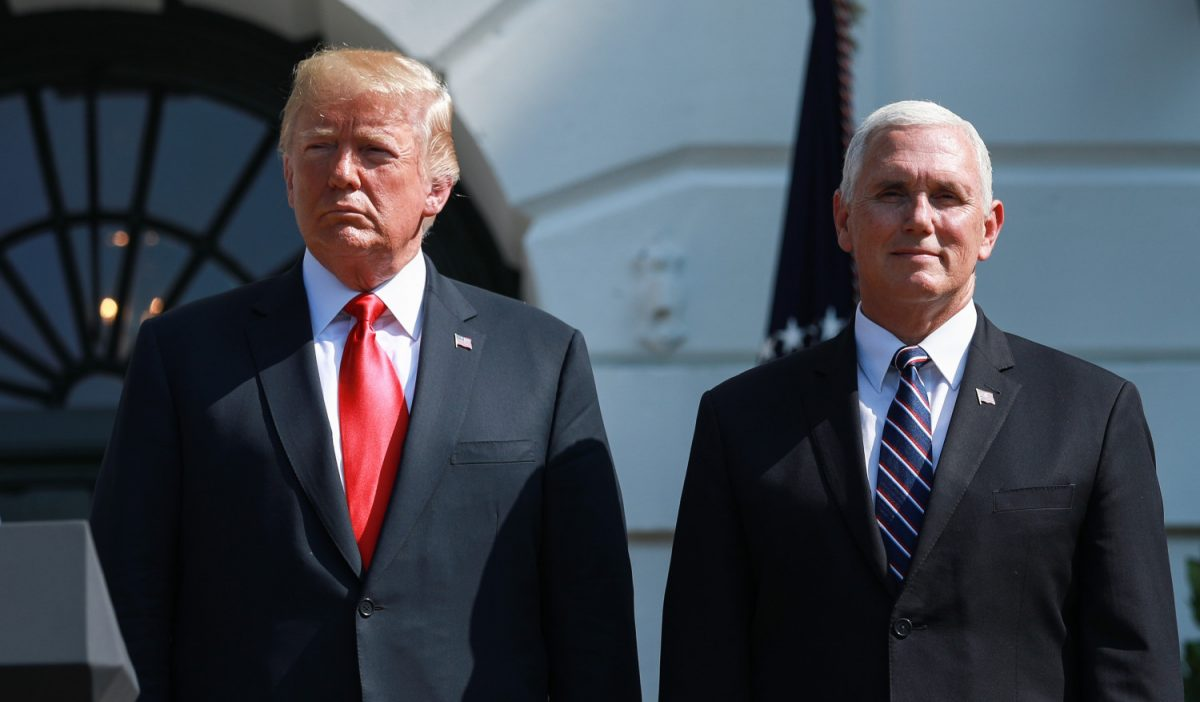 President Donald Trump delivers remarks, as Vice President Mike