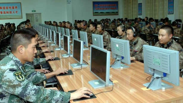 Chinese soldiers work at computers