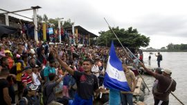 Migrant Caravan Tears Down Fence at Guatemala Border