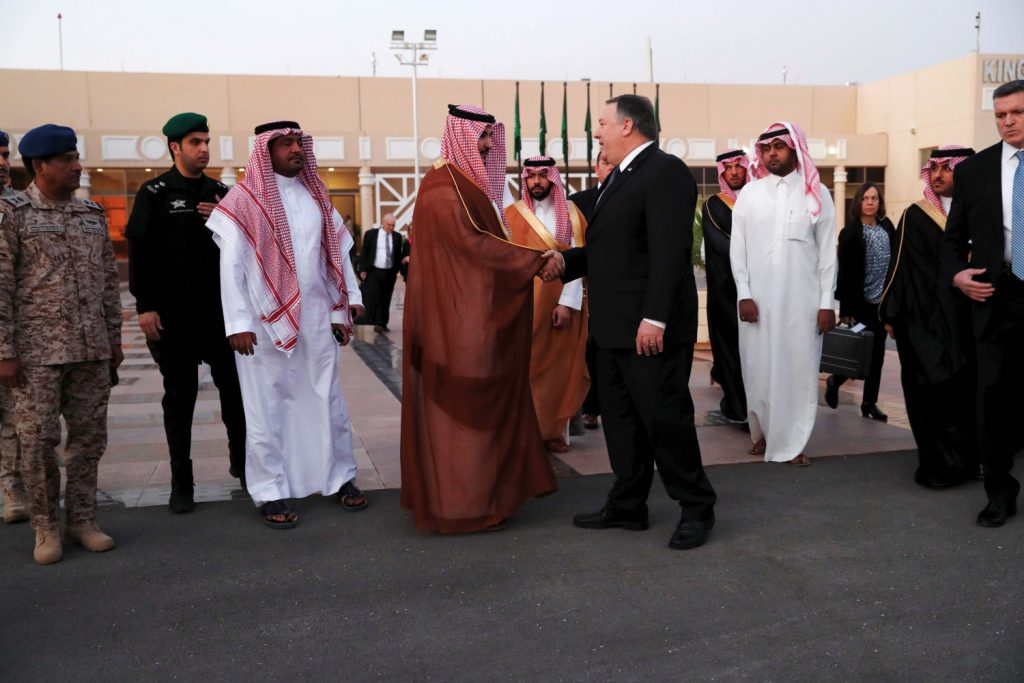 U.S. Secretary of State Mike Pompeo shakes hands with a Saudi official