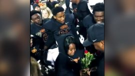 Football Team Helps Coach With Surprise Marriage Proposal