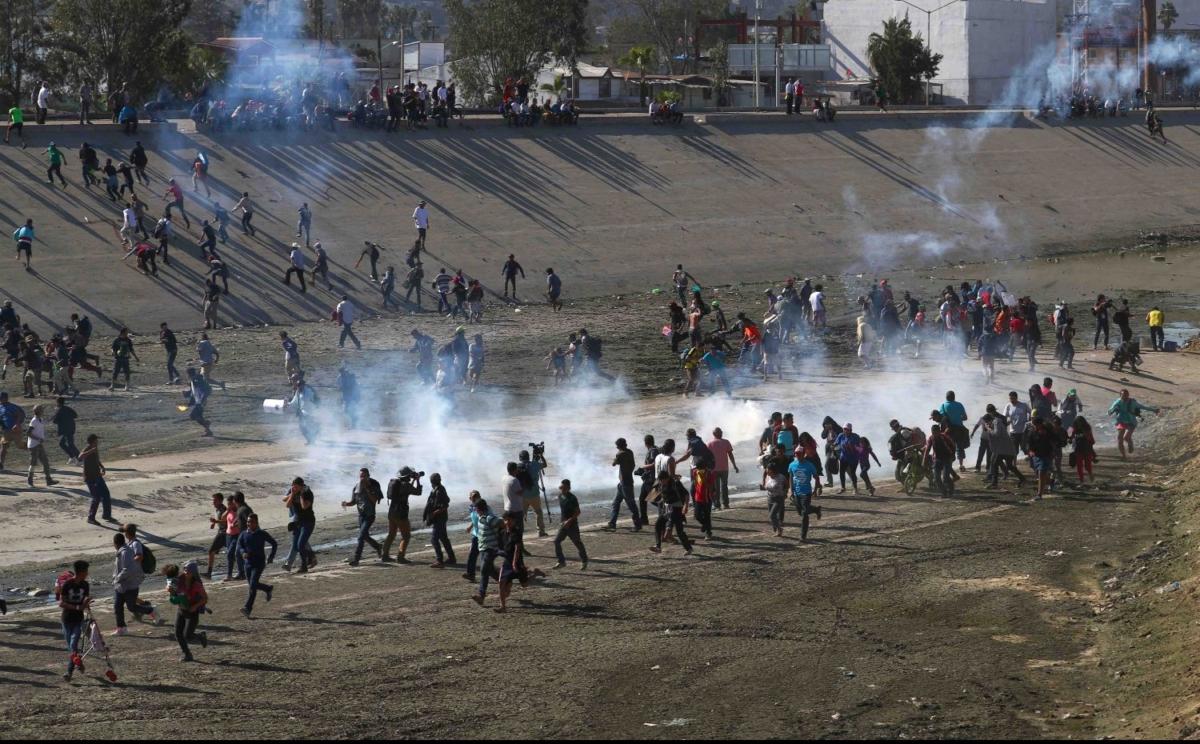 Migrants storm the U.S. Mexico border