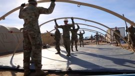 US Troops Construct Tents in Encampment on Border Base
