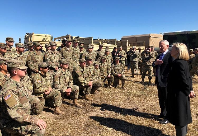 U.S. Defense Secretary Mattis alongside Secretary of Homeland Security Nielsen addresses troops at Base Camp Donna in Donna