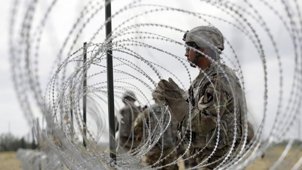 soldiers are installing wires on the border