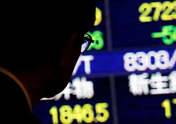 Stock quotation board outside a brokerage in Tokyo, Japan