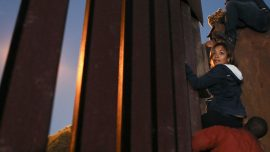 Migrants Climb Over Fence at Tijuana Border