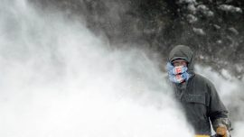 Deadly Blizzard Fizzles to Heavy Rain, but Some Still Digging out of Snow