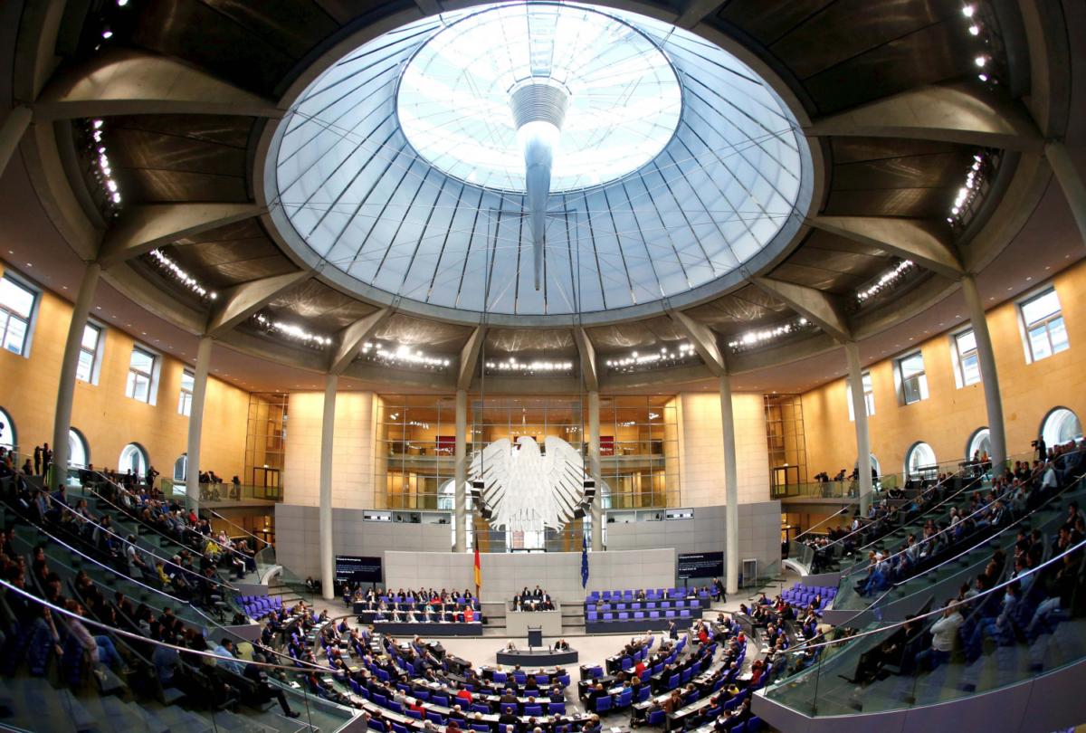 German Chancellor Angela Merkel addresses the lower house of parliament Bundestag