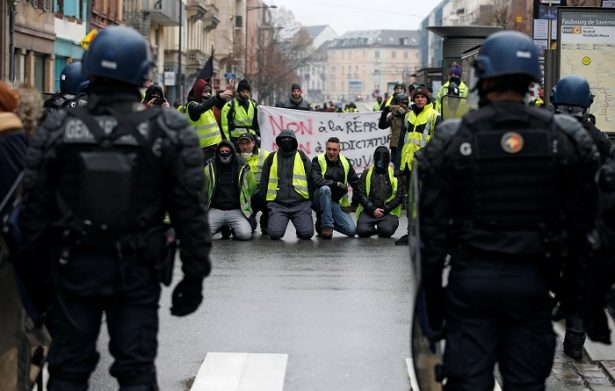 "Protesters taking part in a demonstration of the ""yellow vests"" movement face French Gendarmes in Strasbourg"