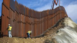 Caught on Camera: Migrants Scale Border Wall