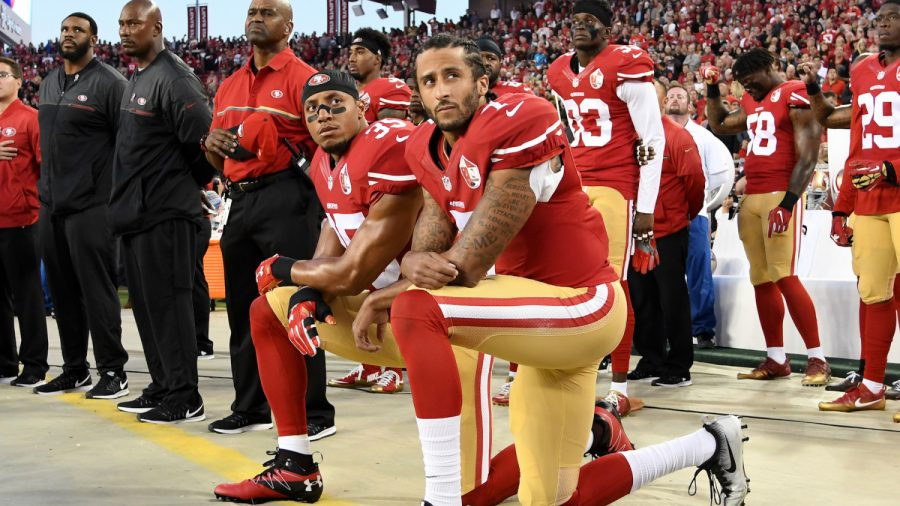 Panthers' Eric Reid Plans to Kneel for Anthem