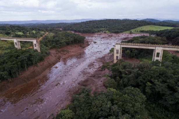 collapsed bridge caused by flooding triggered by a dam collapse