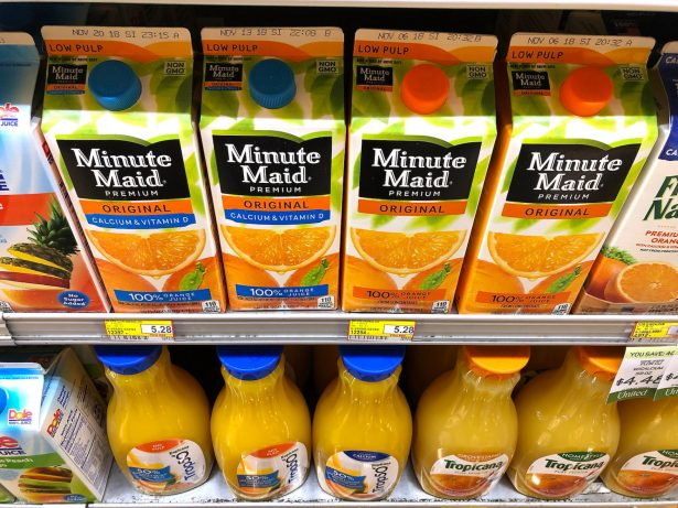 Containers of orange juice at grocery store.