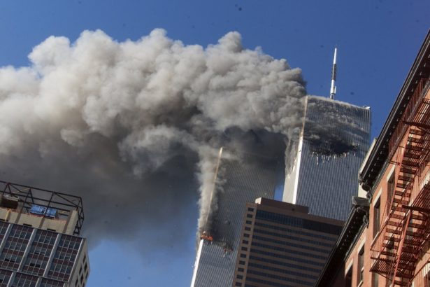 Smoke rises from the burning twin towers of the World Trade Center