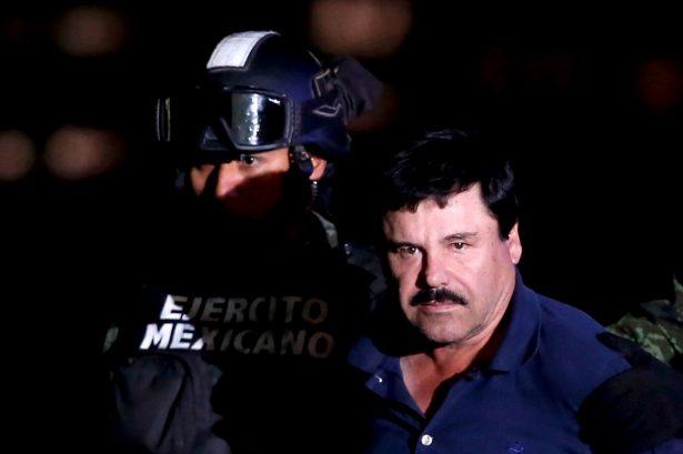 """Joaquin """"El Chapo"""" Guzman is escorted by soldiers"""