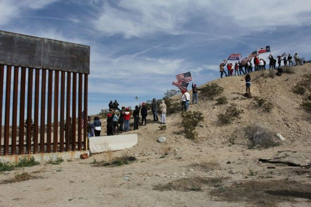 border wall demonstrators form human wall
