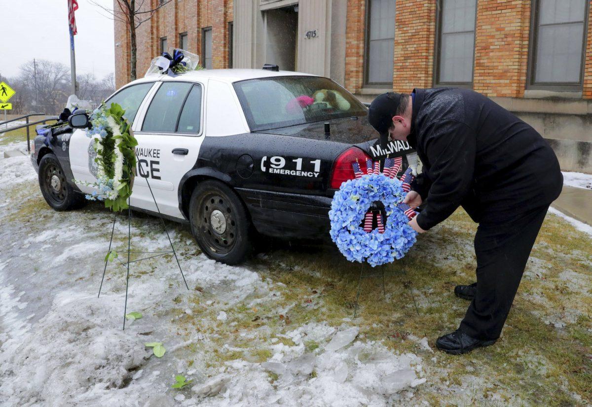 Milwaukee Police officer shot 4