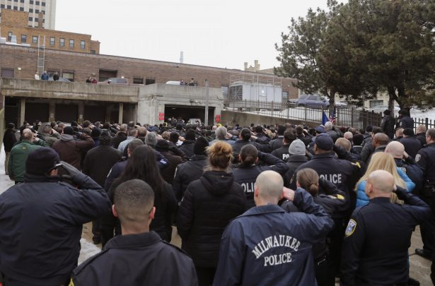 hundreds of police officers salute