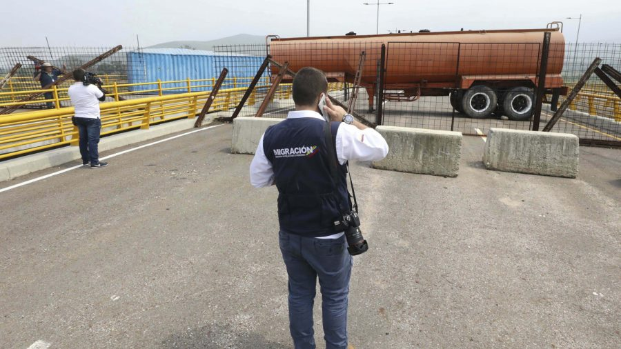 Venezuela Military Barricades Key Bridge to Stop Aid and Food