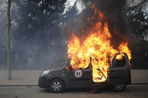 A burning command car belonging to France's anti-terror