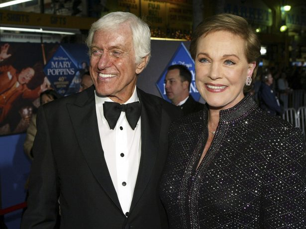 Julie Andrews (R) poses with actor Dick Van Dyke