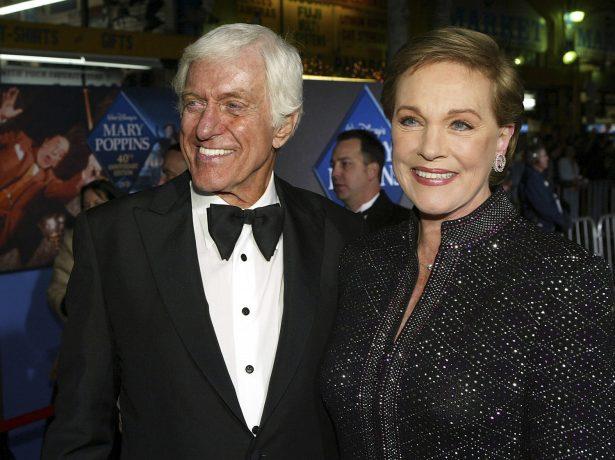 Julie Andrews (R) poses with actor Dick Van Dyke