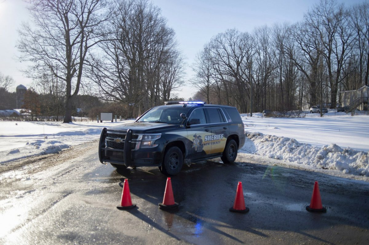 Kent County Sheriff personnel investigate the scene of a fatal shooting