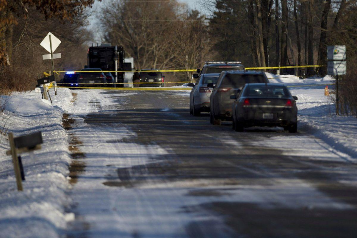 Kent County Sheriff personnel investigate the scene
