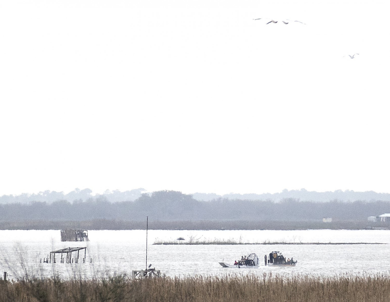Emergency personnel work at the scene of a plane crash site in Trinity Bay in Anahuac Texas on Feb. 23 2019