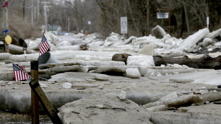 Heavy rain atop frozen ground causes flooding in Midwest