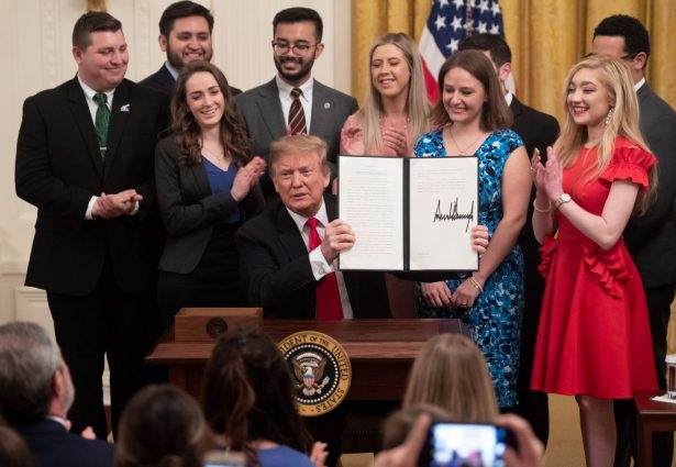 President Donald Trump signs an executive order