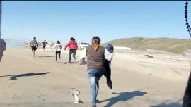 Dozens of Migrants Breach Border Wall in San Diego, Break Into US