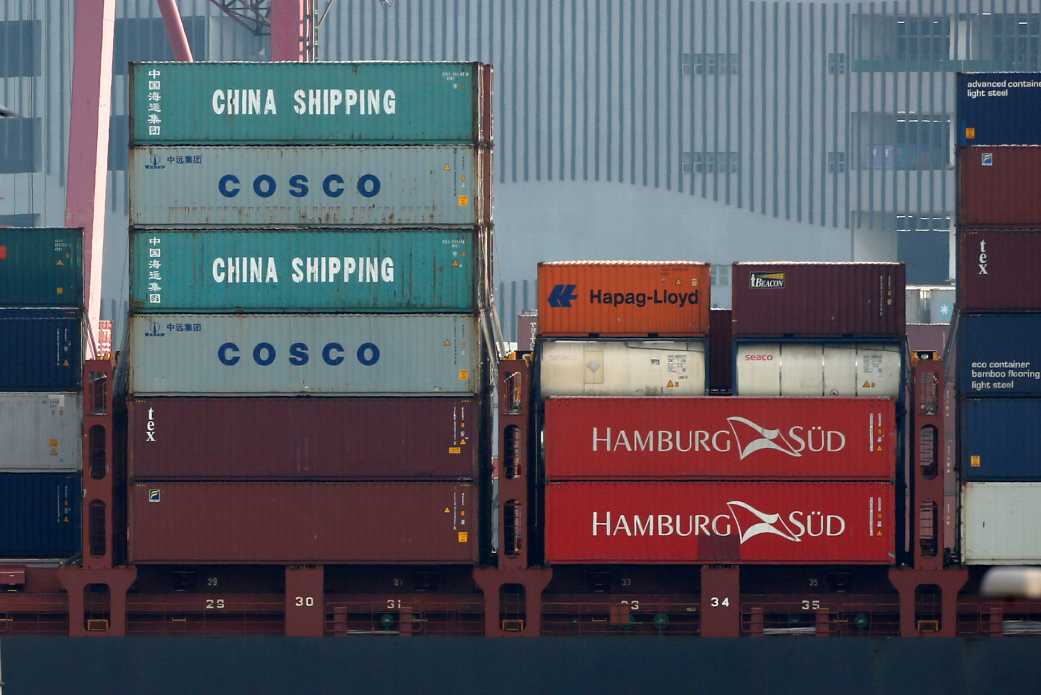Shipping containers of China Shipping and COSCO are seen on a container ship at Kwai Tsing Container Terminals in Hong Kong