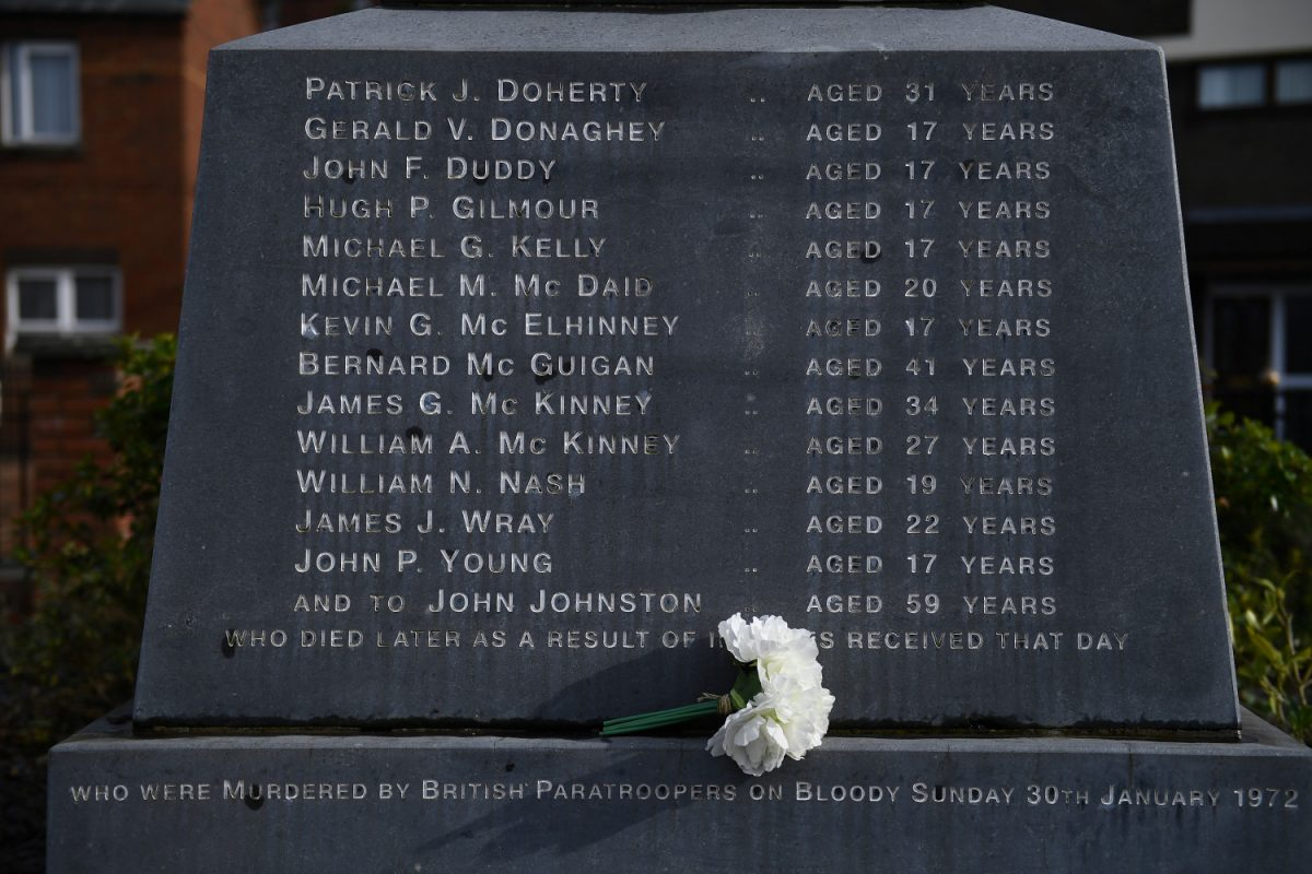 Flowers are left at the memorial for the people who died during Bloody Sunday