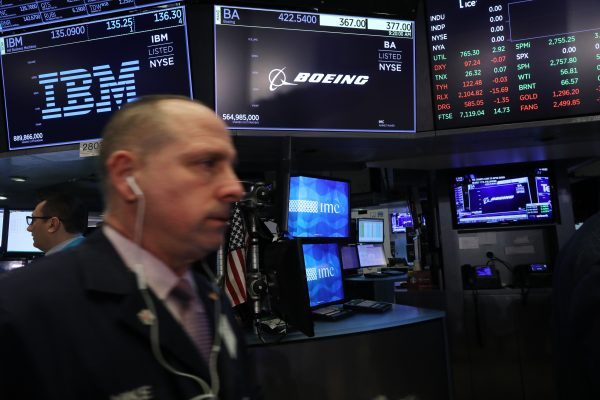 A Boeing stock sign is displayed on a screen on the floor of the New York Stock Exchange